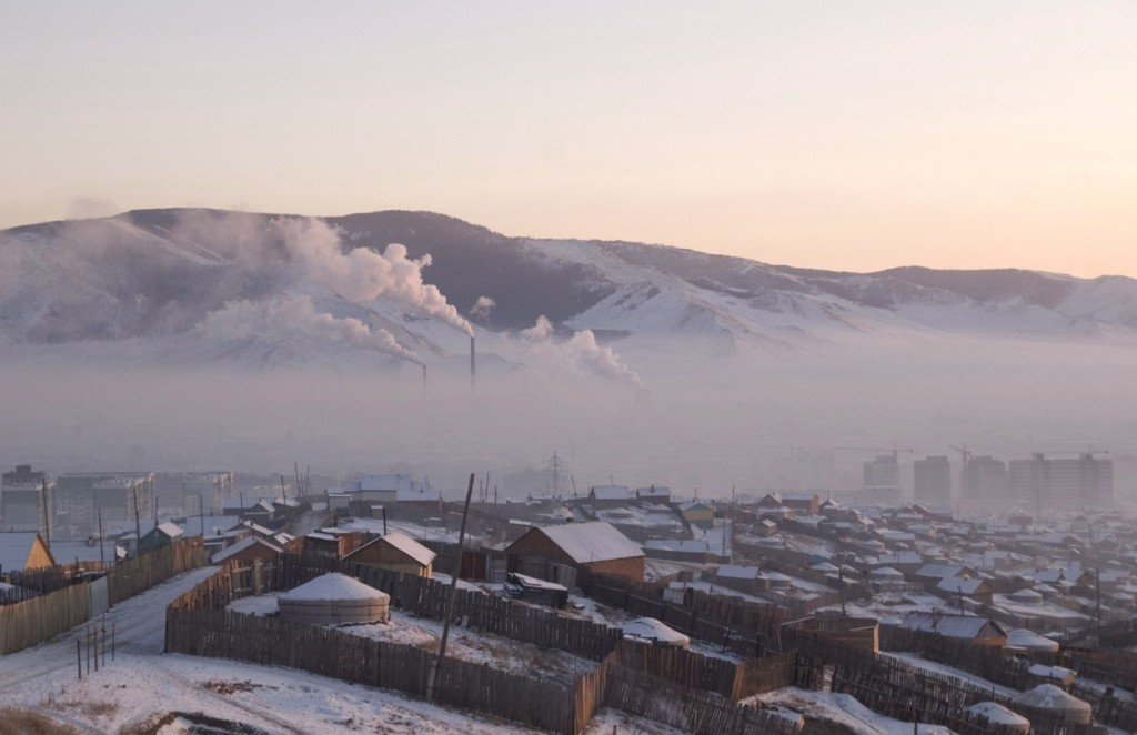 Pollution hangs over Ulaanbaatar in Mongolia, where many of the 1.3 million residents burn wood and coal to keep warm. Photograph: Peter Oetzmann/EPA.