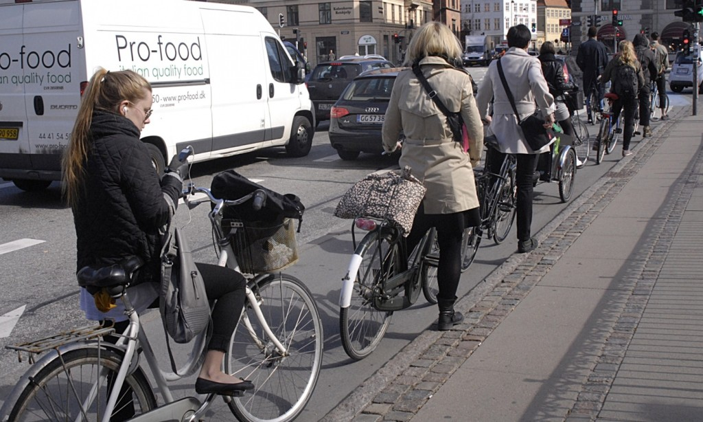 Cyclists in Copenhagen queue patiently for traffic lights – better design leads to better behaviour. Photograph: Francis Dean/Rex