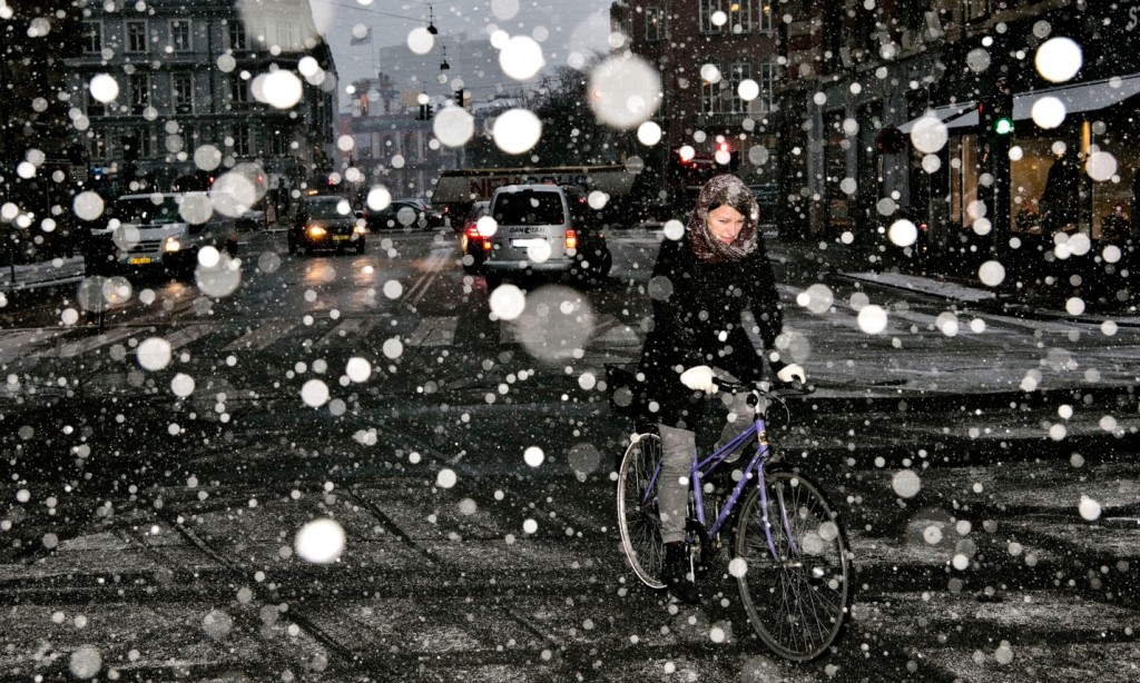 A woman rides her bike in heavy snow in Copenhagen. Photograph: Joachim Adrian/Polfoto